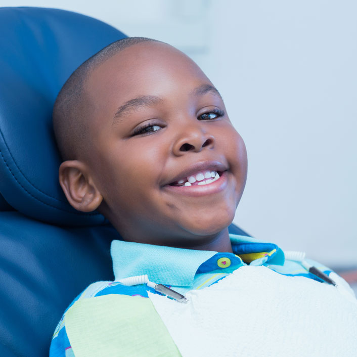 young black boy smiling in dentist chair