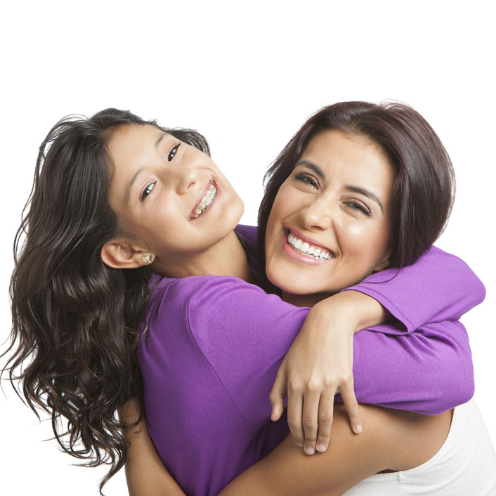 mom and daughter in purple hugging